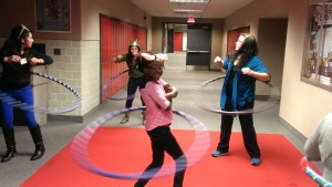 Some of the girls playing around, hula hooping, and having a good time!